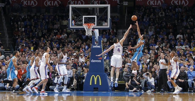 Oklahoma City Thunder's Nick Collison (4) defends a shot by New Orleans Hornets' Brian Roberts (22) during the NBA basketball game between the Oklahoma CIty Thunder and the New Orleans Hornets at the Chesapeake Energy Arena on Wednesday, Dec. 12, 2012, in Oklahoma City, Okla.   Photo by Chris Landsberger, The Oklahoman