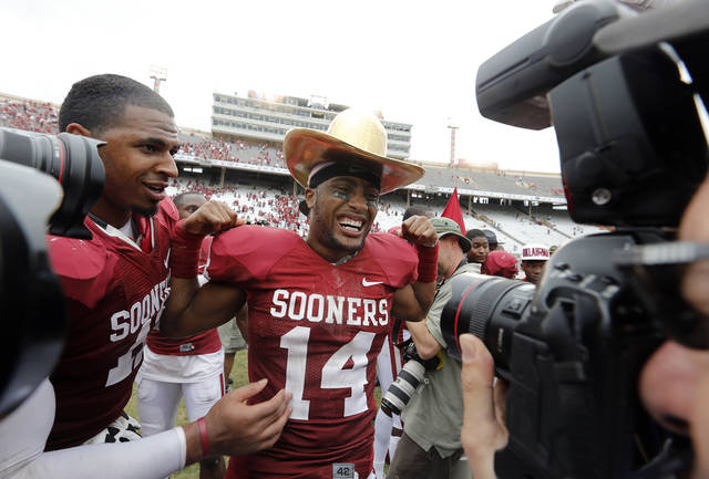 OU&#039;s Aaron Colvin (14) wears the Golden Hat Trophy after the Sooner&#039;s 63-21 win over Texas during the Red River Rivalry college football game between the University of Oklahoma (OU) and the University of Texas (UT) at the Cotton Bowl in Dallas, Saturday, Oct. 13, 2012. Photo by Chris Landsberger, The Oklahoman