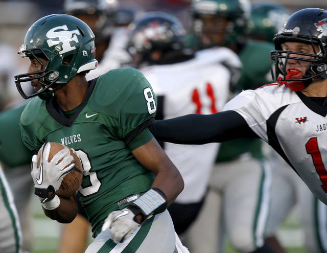 Edmond Santa Fe's Tre Kelley goes past Westmoore's Josh Morgan during a high school football game at Wantland Stadium in Edmond, Okla., Friday, Sept. 23, 2011. Photo by Bryan Terry, The Oklahoman ORG XMIT: KOD