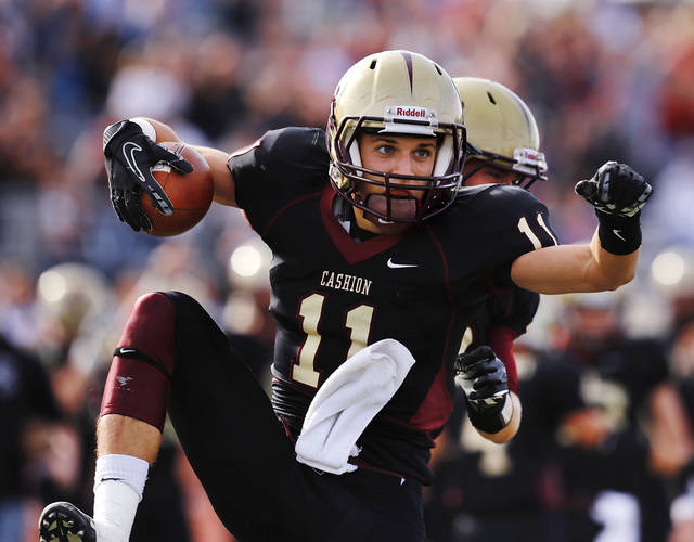 Cashion wide receiver Joe Neece leaps from his feet as he celebrates with a teammate after catching a pass in the end zone to score the Wildcats' first touchdown. Cashion vs. Wynnewood at Norman in a Class A semifinal football game, Saturday, Dec. 1, 2012.     Photo by Jim Beckel, The Oklahoman
