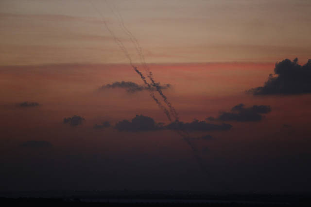 Rockets launched by Palestinian militants towards Israel make their way from the central Gaza Strip, seen from the Israel Gaza border, Monday, Nov. 19, 2012. Israeli aircraft struck crowded areas in the Gaza Strip and killed a senior militant with a missile strike on a media center Monday, driving up the Palestinian death toll to 96, as Israel broadened its targets in the 6-day-old offensive meant to quell Hamas rocket fire on Israel. (AP Photo/Lefteris Pitarakis)