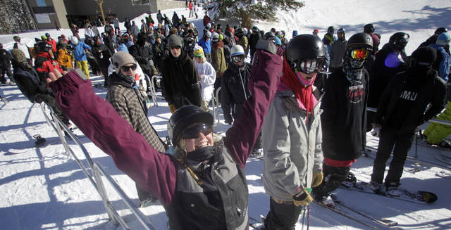 This Nov. 13, 2012 photo shows skiers gather in line for the chair lift during the first day of their ski season at the Brighton Ski Resort in the Wasatch Range, in Utah. The Brighton Ski Resort is in middle of the Wasatch Range's 7 resorts. If the resorts were to be combined, the Utah resorts could offer North America's largest skiing complex _ three times the size of Vail and twice as big as Whistler Blackcomb in British Columbia. (AP Photo/Rick Bowmer)