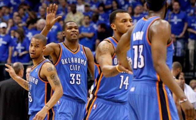 Oklahoma City's Kevin Durant (35) reacts beside Eric Maynor (6) during game 2 of the Western Conference Finals in the NBA basketball playoffs between the Dallas Mavericks and the Oklahoma City Thunder at American Airlines Center in Dallas, Thursday, May 19, 2011. Photo by Bryan Terry, The Oklahoman