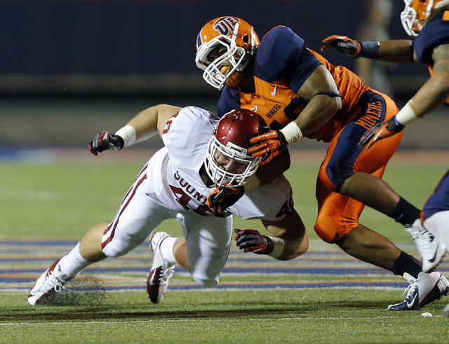 Oklahoma Sooners fullback Aaron Ripkowski (48) blocks UTEP Miners defensive lineman Roy Robertson (43) during the college football game between the University of Oklahoma Sooners (OU) and the University of Texas El Paso Miners (UTEP) at Sun Bowl Stadium on Saturday, Sept. 1, 2012, in El Paso, Texas.  Photo by Chris Landsberger, The Oklahoman