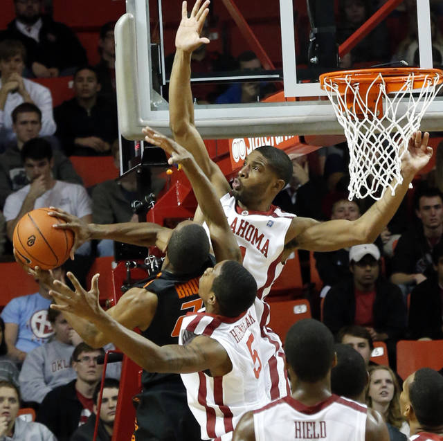 Cowboy's Markel Brown (22) tries to shoot defended by Sooner's Cameron Clark, top, and Je'lon Hornbeak (5) during the second half as the University of Oklahoma Sooners (OU) defeat  the Oklahoma State Cowboys (OSU) 77-68  in NCAA, men's college basketball at The Lloyd Noble Center on Saturday, Jan. 12, 2013  in Norman, Okla. Photo by Steve Sisney, The Oklahoman