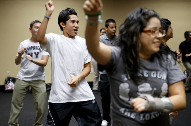 Justin Reyes, 15, participates in a Zumba class at ASTEC Charter School. Photo by Bryan Terry, The Oklahoman