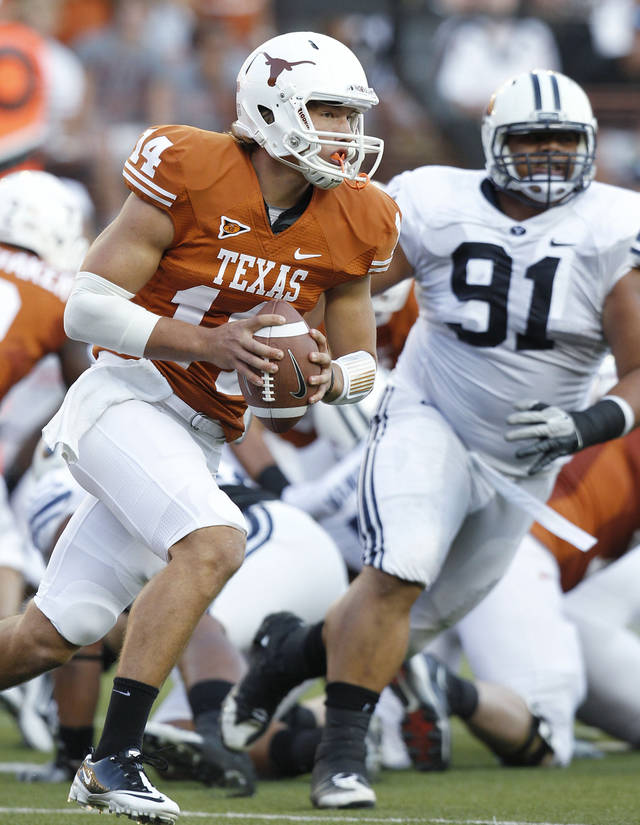 Texas' David Ash (14) tries to avoid BYU defender Hebron Fangupo (91) during the first quarter of an NCAA college football game, Saturday, Sept. 10, 2011, in Austin, Texas. (AP Photo/Eric Gay) <strong>Eric Gay</strong>