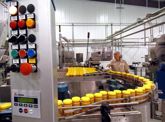 FILE - An Aug. 10, 2005 file photo shows the peanut butter production line at Sunland Inc's peanut plant in Portales, N.M. (AP Photo/Albuquerque Journal, Richard Pipes)