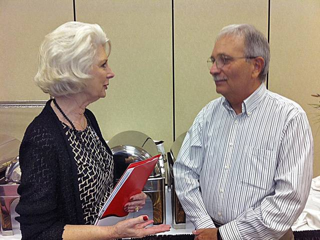 Author Michael Thomas visits with Edmond interior designer Carolyn Sandusky about at the 2012 Senior Summit held Tuesday in Oklahoma City. <strong>Provided - Provided</strong>
