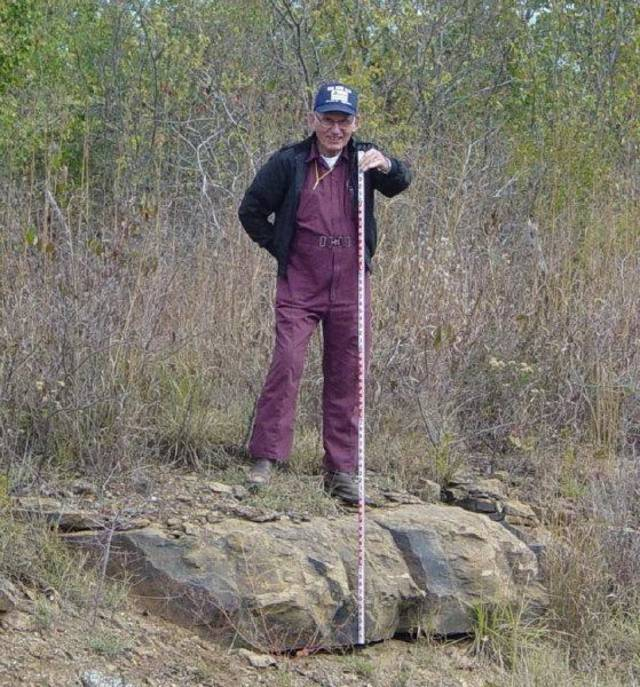 Geologist J. Glenn Cole stands on a limestone outcropping near Bluejacket in 2005. <strong> - provided</strong>