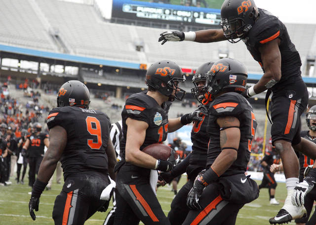 Oklahoma State celebrates a Charlie Moore (17) touchdown during the Heart of Dallas Bowl football game between the Oklahoma State University (OSU) and Purdue University at the Cotton Bowl in Dallas,  Tuesday,Jan. 1, 2013. Photo by Sarah Phipps, The Oklahoman