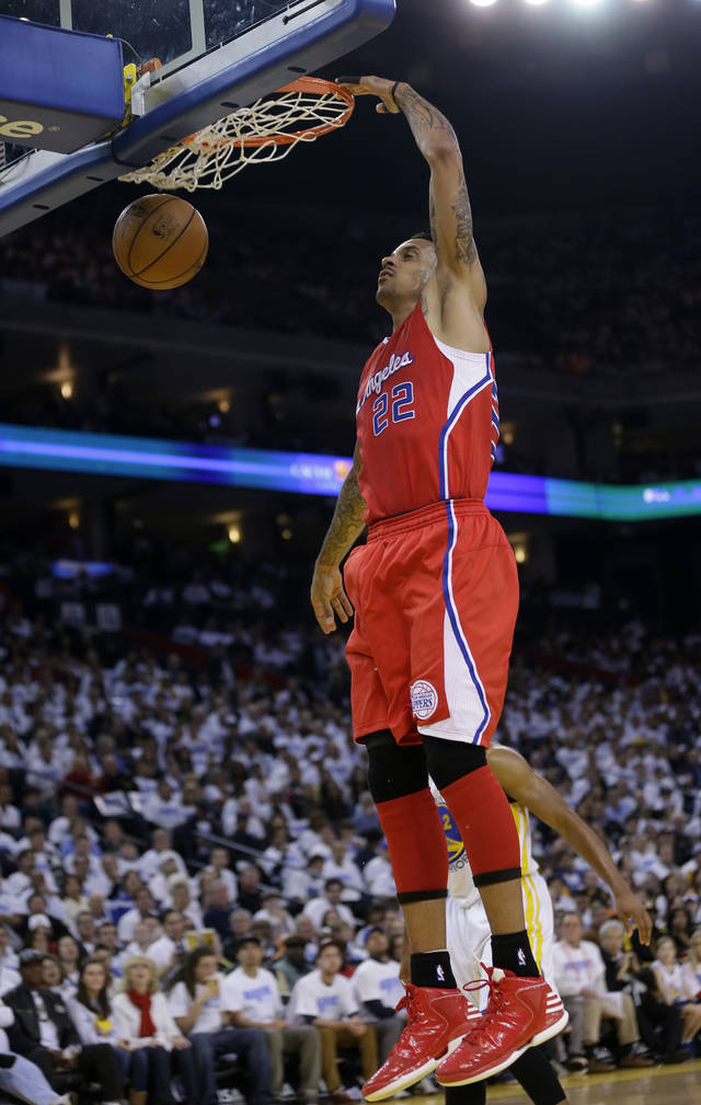 Los Angeles Clippers' Matt Barnes (22) dunks against the Golden State Warriors during the first half of an NBA basketball game in Oakland, Calif., Wednesday, Jan. 2, 2013. (AP Photo/Marcio Jose Sanchez)