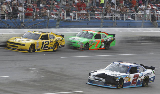 Sam Hornish Jr. (12) puts Danica Patrick (7) into the wall on the final lap of the Nationwide Series auto race at Talladega Superspeedway in Talladega, Ala., Saturday, May 5, 2012. Patrick retaliated on the cool down lap, hitting Hornish with her car. (AP Photo/Butch Dill)
