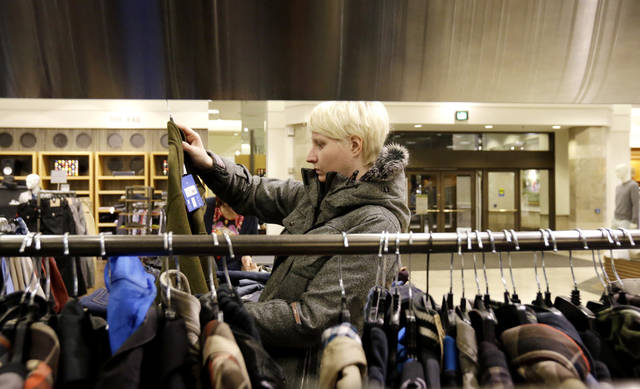 A woman shops for sales at a Nordstrom store Jan. 10 in Chicago.  AP Photo