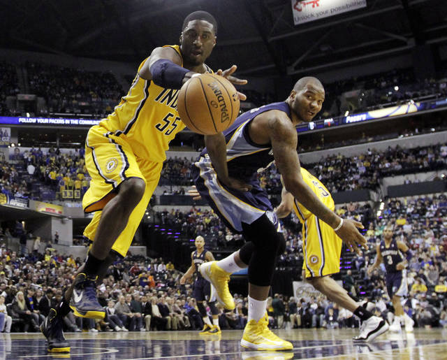 Indiana Pacers' Roy Hibbert (55) battles Memphis Grizzlies' Marreese Speights (5) for a loose ball during the first half of an NBA basketball game, Monday, Dec. 31, 2012, in Indianapolis. (AP Photo/Darron Cummings)