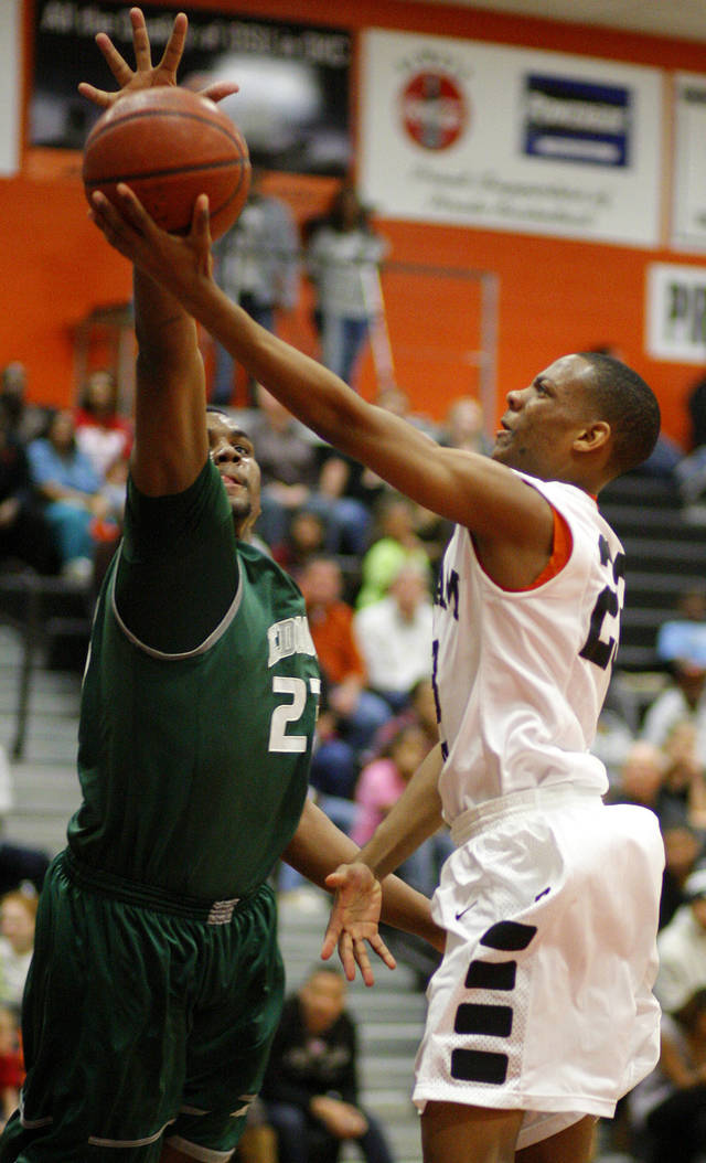 Edmond Santa Fe's Shaquille Morris, left, blocks the shot of Putnam City's Marc Perry during a high school basketball game at Putnam City in Oklahoma City, Tuesday, Feb. 7, 2012. Photo by Bryan Terry, The Oklahoman