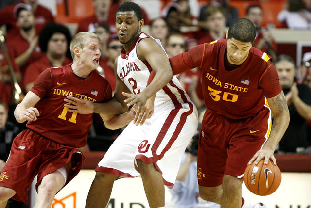 Oklahoma's Steven Pledger (2) gets caught between Iowa State's Scott Christopherson (11) and Royce White (30) during an NCAA basketball game between the University of Oklahoma Sooners (OU) and the Iowa State Cyclones (ISU) at the Lloyd Noble Center in Norman, Saturday, Feb. 4, 2012. Photo by Bryan Terry, The Oklahoman