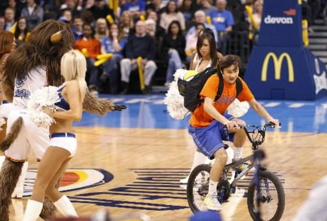 "Actor Taylor Gray rides through a group of the Oklahoma City Thunder Girls dance group during rehearsal for the movie ""Thunderstruck"" in Oklahoma City, Tuesday, Jan. 24, 2012. Thunder's Kevin Durant appears as himself in the movie. (AP Photo/Sue Ogrocki)"