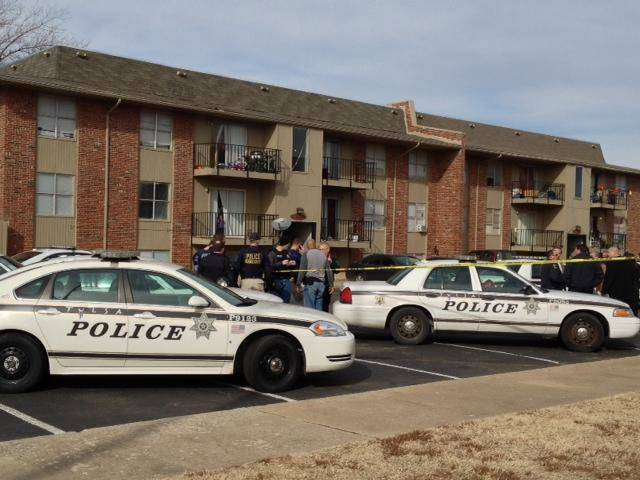 Police gather at the scene of a multiple homicide at the Fairmont Terrace apartment complex in Tulsa on Monday. MATT BARNARD/Tulsa World