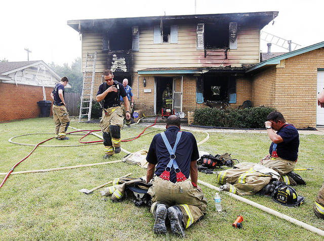 Oklahoma City firefighters work to put out a house fire Thursday at 908 NE 81 in Oklahoma City.  Photo by Paul B. Southerland, The Oklahoman