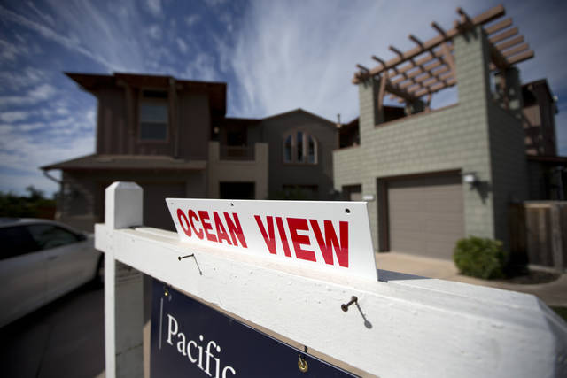 This Wednesday, Nov. 14, 2012, photo, shows a home for sale in Leucadia, Calif.. U.S. home prices accelerated in November compared with a year ago, pushed higher by rising sales and a tighter supply of available homes (AP Photo/Gregory Bull)