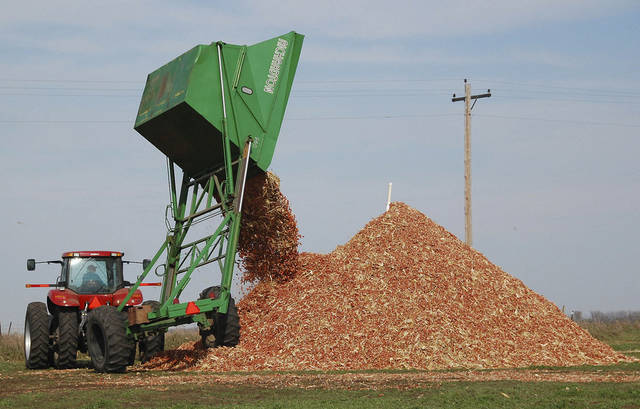 A dump wagon adds freshly gathered corn cobs to a pile on a farm near Hurley, S.D. AP Photo