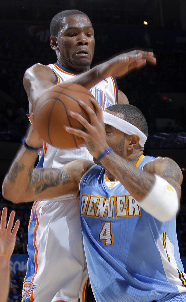 Oklahoma City's Kevin Durant (35) defends on Denver's Kenyon Martin (4) during the first round NBA playoff game between the Oklahoma City Thunder and the Denver Nuggets on Sunday, April 17, 2011, in Oklahoma City, Okla. Photo by Chris Landsberger, The Oklahoman