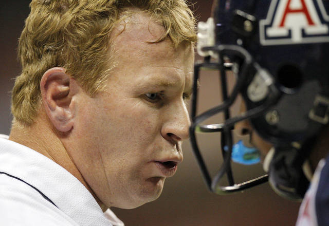 Arizona head coach Mike Stoops talks to a player during the Valero Alamo Bowl college football game between the Oklahoma State University Cowboys (OSU) and the University of Arizona Wildcats at the Alamodome in San Antonio, Texas, Wednesday, December 29, 2010. Photo by Nate Billings, The Oklahoman
