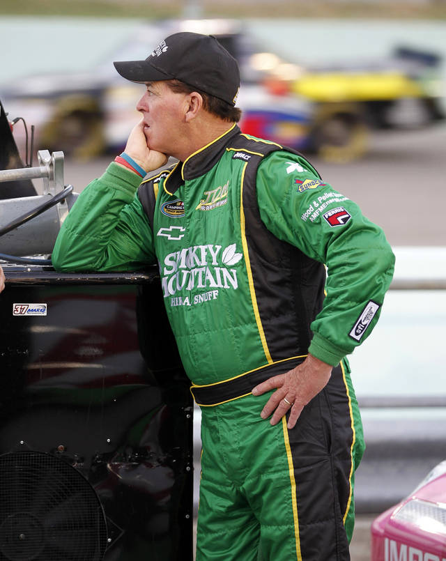 Ron Hornaday Jr. waits to drive qualifying laps for the NASCAR Trucks Series auto race, Friday, Nov. 16 2012 at the Homestead-Miami Speedway in Homestead, Fla. (AP Photo/Terry Renna)