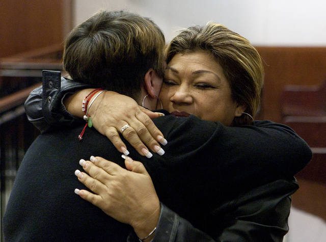 Tiffany Dickerson, left, hugs Rosie Castillo after Jessica Tata's sentencing Tuesday, Nov. 20, 2012, in Houston. Tata was sentenced to 80 years for her felony murder conviction of Elias Castillo, one of four children killed in a fire at her home day care in Houston. Dickerson also lost her son, three-year-old Shomari Dickerson, in the fire. (AP Photo/Houston Chronicle, Cody Duty)