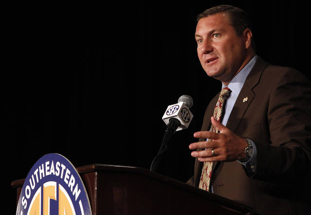Mississippi State coach Dan Mullen speaks to the media at the Southeastern Conference NCAA college football media day in Hoover, Ala. on Wednesday, July 18 , 2012. (AP Photo/Butch Dill)