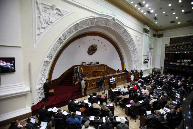 Members of Venezuela's National Assembly attend a session in Caracas, Venezuela, Tuesday, Jan. 8, 2013. President Hugo Chavez won't be able to attend his scheduled swearing-in this week, Venezuela's government announced, confirming suspicions that the leader's illness will keep him in a Cuban hospital past the key date. (AP Photo/Fernando Llano)