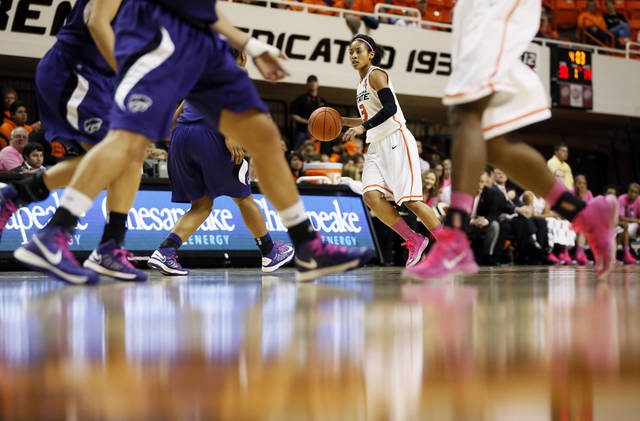 Oklahoma State's Tiffany Bias (3) dribbles during an NCAA women's basketball game between Oklahoma State University (OSU) and Kansas State at Gallagher-Iba Arena in Stillwater, Okla., Saturday, Feb. 16, 2013. The teams wore pink on their shoes as part of Play 4Kay, an initiative to raise awareness of breast cancer and funds for research. Photo by Nate Billings, The Oklahoman