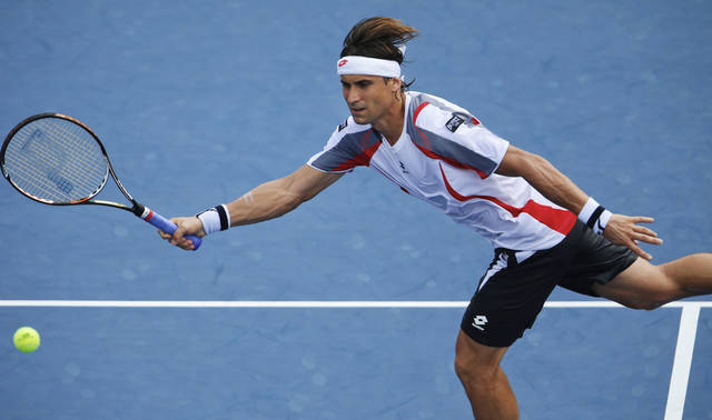 Spain's David Ferrer returns a shot to Richard Gasquet, of France, in the fourth round of the 2012 US Open tennis tournament, Tuesday, Sept. 4, 2012, in New York. (AP Photo/Julio Cortez)