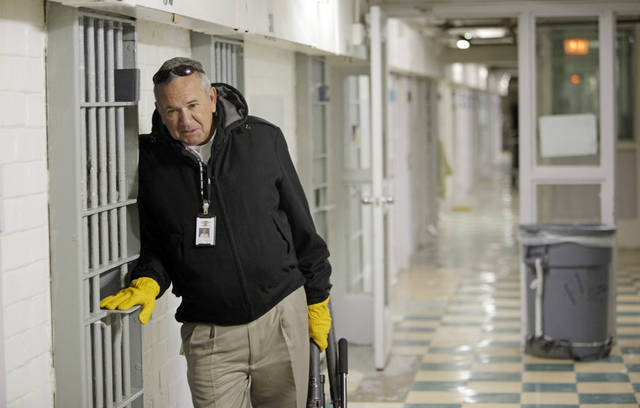 Dale Cantrell, a disciplinary hearing officer, talks to an offender at the Oklahoma State Penitentiary in McAlester, Okla., Wednesday, Dec. 7, 2011. Photo by Nate Billings, The Oklahoman