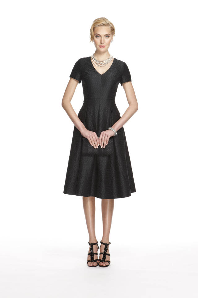 "This image released by Banana Republic shows a black jacquard party dress from a limited-edition collection designed by Banana Republic. Led by Creative Director and EVP, Simon Kneen, and styled and curated by ""Anna Karenina"" costume designer Jacqueline Durran, the collection is currently available in Banana Republic stores. AP PHOTO <strong> - AP</strong>"