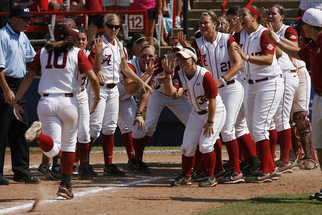 Alabama players celebrate with Kaila Hunt, left, after a home run Sunday. Photo by Garett Fisbeck, The Oklahoman