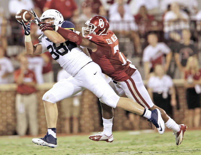 Oklahoma's Corey Nelson breaks up a pass intended for Cody Clay of West Virginia.   Photo by Steve Sisney, The Oklahoman