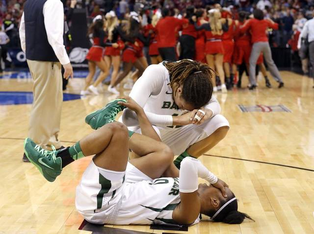 Baylor's Brittney Griner (42) and Odyssey Sims (0) react after losing to Louisville following the college basketball game between Baylor University and the Louisville at the Oklahoma City Regional for the NCAA women's college basketball tournament at Chesapeake Energy Arena in Oklahoma City, Sunday, March 31, 2013. Photo by Sarah Phipps, The Oklahoman