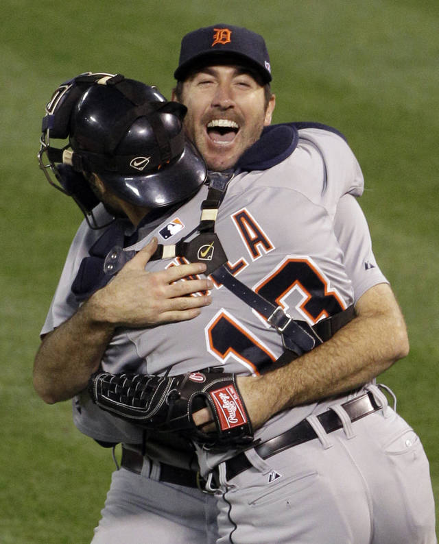 Detroit Tigers starting pitcher Justin Verlander hugs catcher Alex Avila after the Tigers beat the Oakland Athletics 6-0 in Game 5 of an American League division baseball series in Oakland, Calif., Thursday, Oct. 11, 2012. (AP Photo/Eric Risberg)