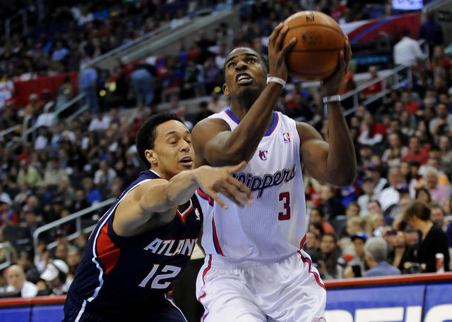 Los Angeles Clippers guard Chris Paul (3) gets by Atlanta Hawks guard John Jenkins (12) while driving to the basket in the second half of an NBA basketball game on Sunday, Nov. 11, 2012, in Los Angeles. The Clippers won 89-76. (AP Photo/Gus Ruelas) ORG XMIT: LAS113