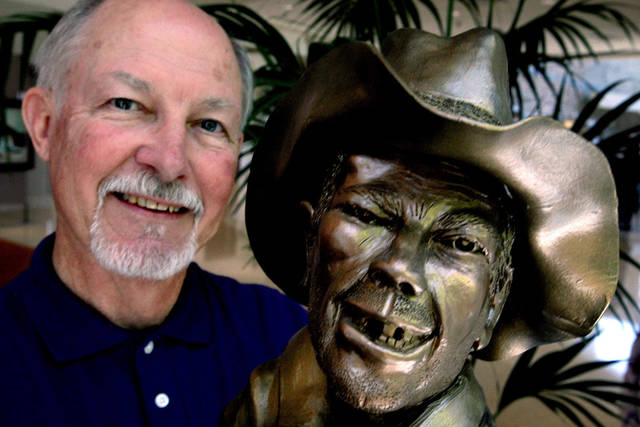 "Bob Willis poses for a portrait with his sculpture ""Bull Ride Survivor"" at Integris Cancer Institute of Oklahoma in Oklahoma City Tuesday, June 22, 2010.  Photo by Miranda Grubbs, The Oklahoman"