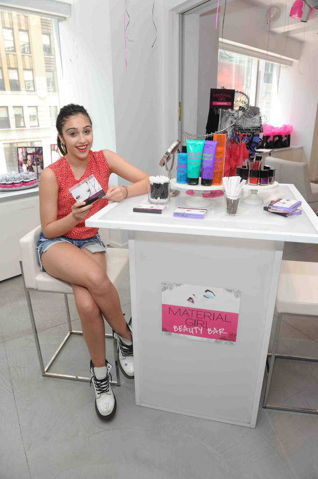 "In this Aug. 2, 2011, publicity image released by Material Girl, Lourdes ""Lola"" Leon, the daughter of pop star Madonna, is shown at the launch of the Material Girl beauty collection in New York. Lourdes, who teamed up with her mother to launch the clothing line named after the popular 80's song, is now expanding to include cosmetics and skin care products. The beauty collection, which is geared towards teens, is available at Macys. (AP Photo/Material Girl)"