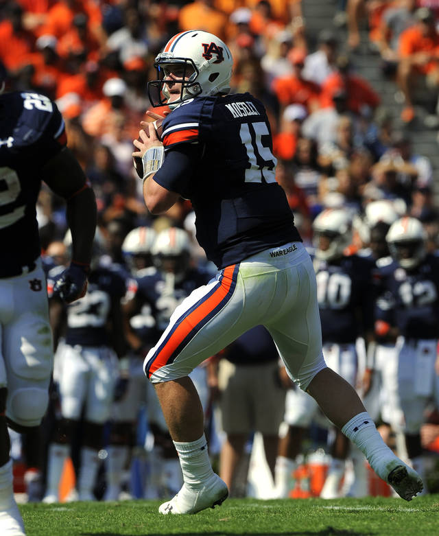 Auburn quaterback Clint Moseley looks for a receiver in the second half of their NCAA college football game against Arkansas on Saturday, Oct. 6, 2012 in Auburn, Ala.(AP Photo/Todd J. Van Emst)