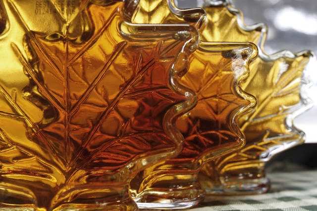 FILE-In this Oct. 27, 2011, file photo, bottles of maple syrup sit in a window in East Montpelier, Vt. Vermonters have grown accustomed to their �fancy� �amber� and �grade B� types of maple syrup but new consumers may not be so sweet on the terms. So the country�s largest producer of the pancake topping is thinking of doing away with those terms and adopting new international names with flavor descriptions to help consumers delineate between four different colored and flavored syrups and to match new worldwide terms. The four classifications would be golden color, delicate taste; amber color, rich taste; dark color, robust taste; and very dark color, strong taste. (AP Photo/Toby Talbot)
