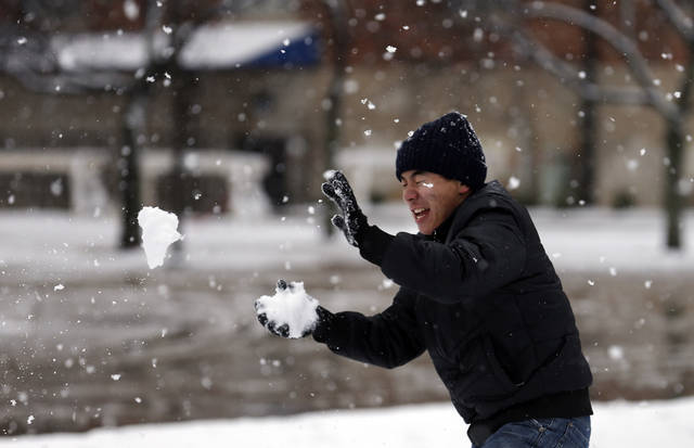 Chris Xiao throws a snowball at the University of Central Oklahoma in Edmond, Okla., Wednesday, Feb. 13, 2013.Photo by Sarah Phipps, The Oklahoman