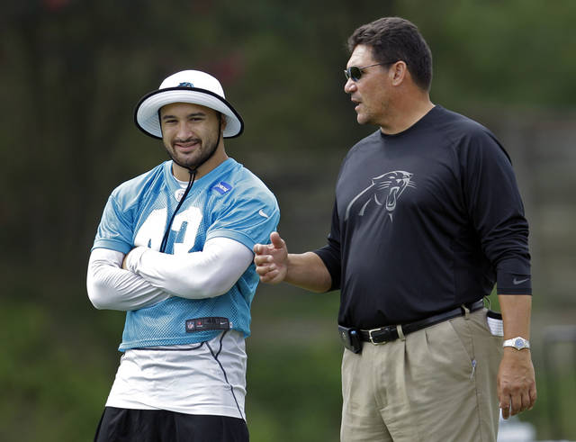 Carolina Panthers' Haruki Nakamura (43) talks with head coach Ron Rivera during practice at the NFL team's football training camp in Spartanburg, S.C., Friday, Aug. 3, 2012. (AP Photo/Chuck Burton)
