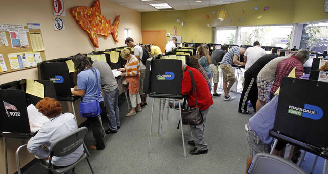   South Floridians mark their ballots during the last day of early voting in Miami Beach, Fla., Saturday, Nov. 3, 2012. Despite record turnout in many parts of the state, Florida Gov. Rick Scott rejected calls to extend early voting through Sunday to help alleviate long lines at the polls. (AP Photo/Alan Diaz)  