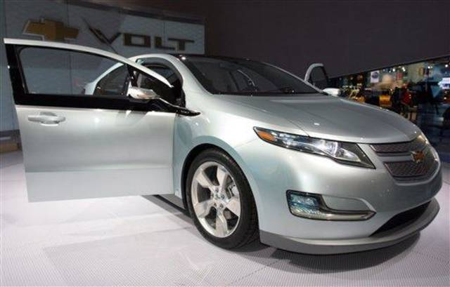 FILE - In this Jan. 17, 2009 file photo, General Motors&#039; Chevy Volt is seen on display during opening day of the North American International Auto Show in Detroit. General Motors Corp. will assemble battery packs for its new rechargeable electric car at a facility south of Detroit, creating about 100 jobs, a person briefed on the plans said Friday, July 17, 2009. (AP Photo/Jerry S. Mendoza, file)