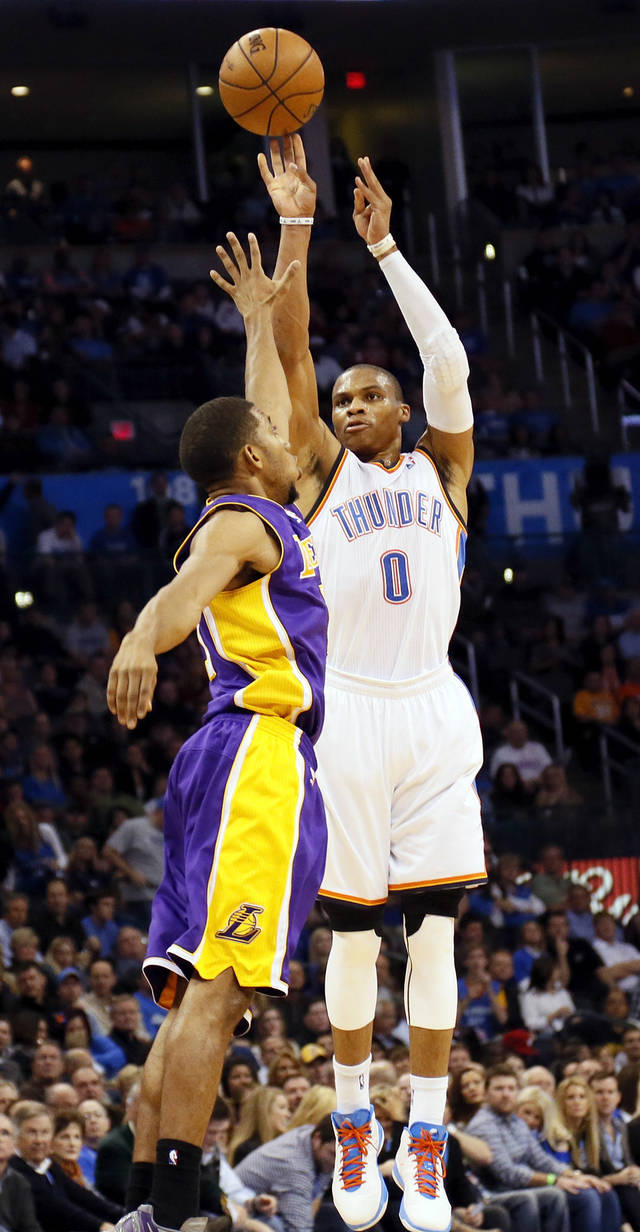 Oklahoma City's Russell Westbrook (0) shoots a three-point shot against Los Angeles' Darius Morris (1) during an NBA basketball game between the Oklahoma City Thunder and the Los Angeles Lakers at Chesapeake Energy Arena in Oklahoma City, Friday, Dec. 7, 2012. Photo by Nate Billings, The Oklahoman